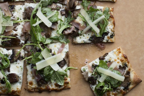 """Billy G's """"Farmhouse White"""" pizza is made with roasted garlic-herb oil, mozzarella and wild mushrooms, then finished with prosciutto, shaved parmesan and arugula. Photos: Billy G's Italian American Restaurant in Kirkwood"""