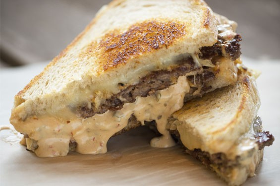 """""""The Dam"""" sandwich consists of two patties covered with American and Swiss cheeses and """"Dam sauce."""" See more photos: The Dam cooks up delicious bar food in south city."""