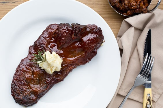 """Joe's Backyard Pork Steak"" brings 24 ounces of bone-in pork butt, topped with St. Louis barbecue sauce.See photos: Gamlin Whiskey House Is a Welcome Retreat"