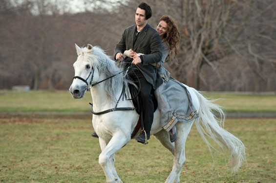 Colin Farrell and Jessica Brown Findlay astride a magic horse in Winter's Tale.