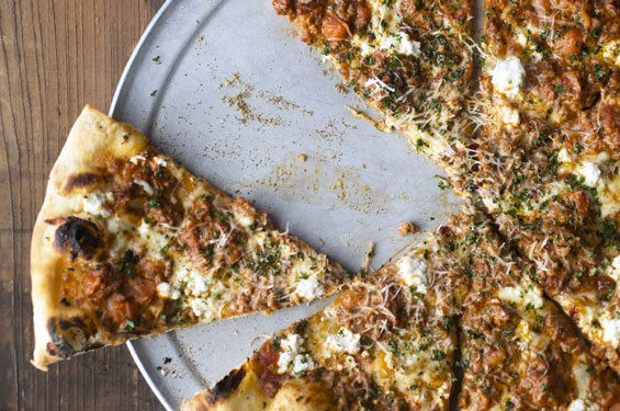 "The ""Bolo"" is a New York-style pizza, topped with extra-virgin olive oil, herbs, mozzarella, ricotta, savory pork and beef bolognese, freshly grated Parmesan and parsley. See photos: Blind Tiger Dishes Divine Pizza in Maplewood"