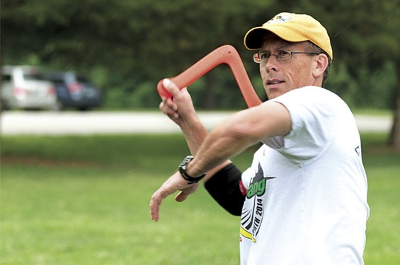 Essig launches a boomerang into the wind at Buder Park.