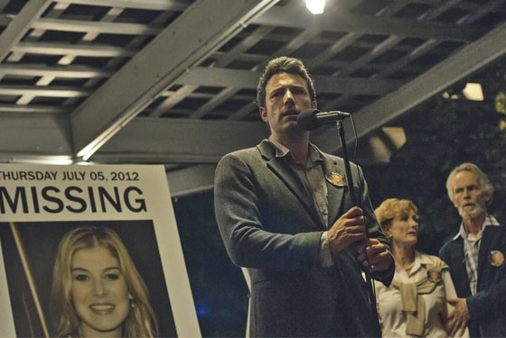 Nick Dunne (Ben Affleck) finds himself the chief suspect behind the shocking disappearance of his wife Amy (Rosamund Pike), on their fifth anniversary in Gone Girl.