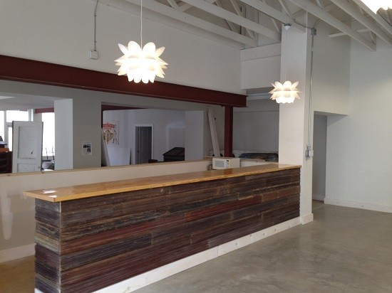 A bar in the events space made of wood found in St. Louis alleys.