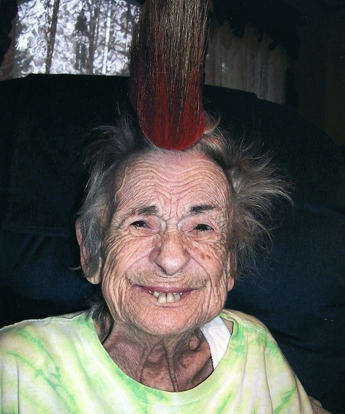 Jewel Airis wears one of her father-in-law's porcupine-quill hair roaches. - COURTESY OF KEVIN AIRIS