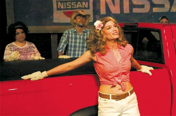 "Taylor Pietz as Heather Stovall sings ""If I Had This Truck."" In the background are Anna Skidis as Norma Valverde and Todd Schaefer as JD Drew. - JILL RITTER LINDBERG"