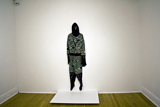 The Y-Man outfit hangs on a wall, waiting for people to come and admire the hand-knitted details. - PHOTOS: EMILY GOOD