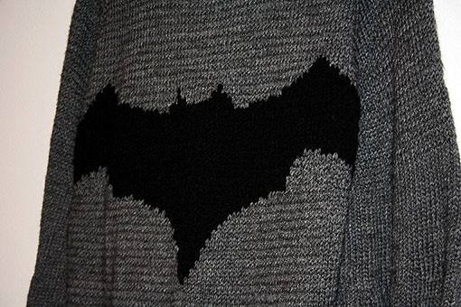 Even the icons that make the costume are precisely knitted. The color can often suggest the hero, but when you see the Bat symbol there's no question in your mind about the hero's identity. - PHOTO: EMILY GOOD
