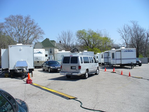 Crew trailers blanket the lot outside Black Cat Theatre in Maplewood.