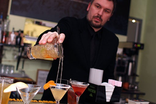 On Saturday night, new downtown restaurant Lola held its grand opening. Here, owner Chris Hansen pours a drink at the party. See our full slideshow -- which includes the food shots -- here. - PHOTO: CRYSTAL ROLFE