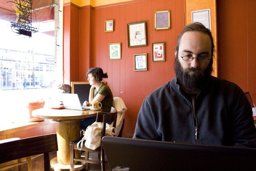 Adam Shriver at Meshuggah Coffee in the Delmar Loop. - PHOTO: EMILY GOOD