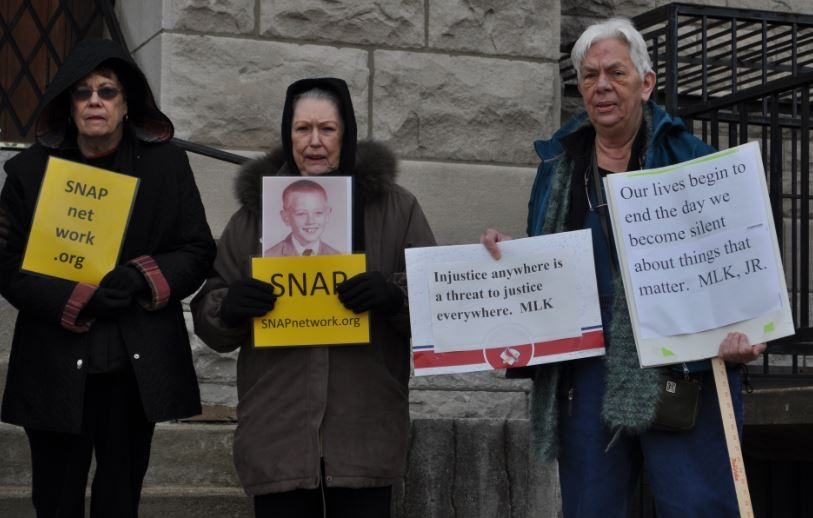 A handful of SNAP members protested outside Wayman Church on Thursday in support of a lawsuit against a minster accused of sexual harassment. - DANNY WICENTOWSKI
