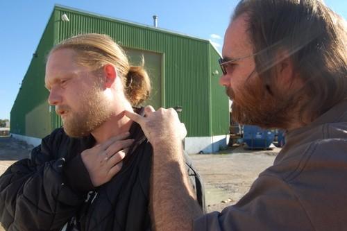 Brett Dagoberg checks his friend's neck for puncture wounds. - LINDSAY TOLER