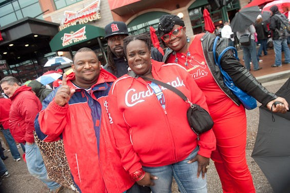 Even rain couldn't keep Cards fans away on home opening day. - JON GITCHOFF