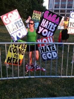 Plaintiff Megan Phelps-Roper protesting in St. Louis last summer.