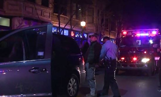 Police arrest the driver of a minivan who stuck three protesters in the Central West End on Wednesday night. - YOUTUBE/SUPERBROTHA