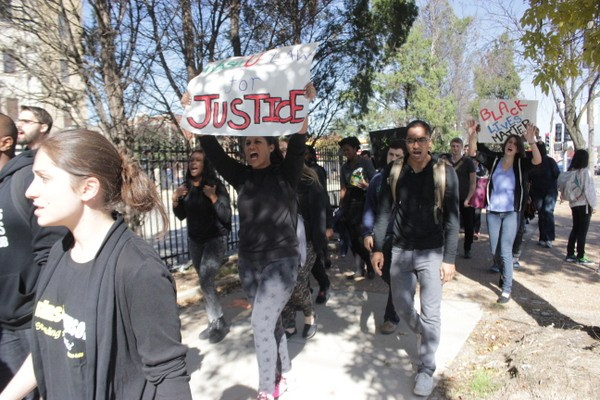 Washington University student protesters march against police brutality in University City. - DANNY WICENTOWSKI