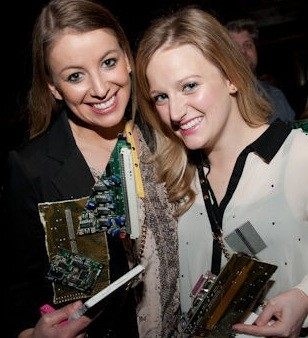 Meme Girls: Herzog and Derus display their RFT Web Awards hardware.
