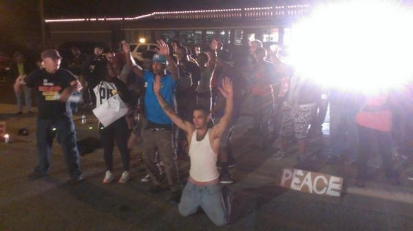 Demonstrators protest Antonio French's arrest outside the Ferguson Police Department. French, an alderman in St. Louis city, is a former journalist and has been filming the unrest. - RAY DOWNS
