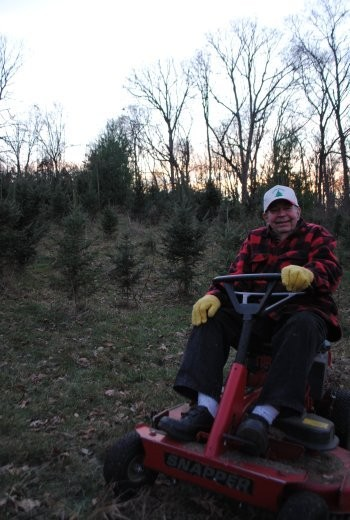 Ralph Lindner puts it in park at his O'Fallon Christmas tree farm. - JULIA GABBERT