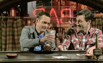 Hamm (right) on-screen with Will Forte on Saturday Night Live.