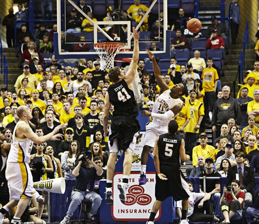 Wichita State's Garrett Stutz rejects a shot by Kwadzo Ahelegbe of Northern Iowa. - PHOTO: STEVE TRUESDELL
