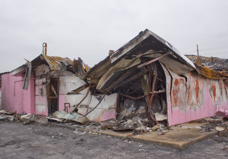 Fire gutted and warped Morris' shop, but historians have given it new life.
