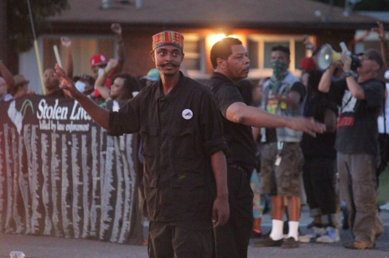 In the absence of police, members of the New Black Panther Party directed traffic and kept the peace during last night's Ferguson protest. - DANNY WICENTOWSKI