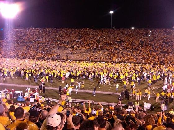 Hundreds of fans rushed onto Faurot Field. Three percent of 'em ended up in cuffs. - PHOTO: DAVE GEETING
