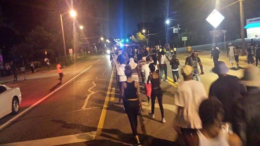 Protesters move south on West Florissant Road. They have to keep moving or risk arrest. - DANNY WICENTOWSKI