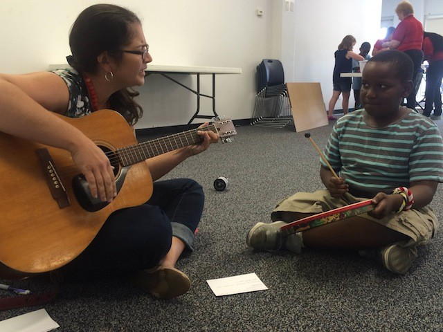 Katie Norvell helps Tacory Kent write a song at the Florissant Valley Library Friday afternoon. - PHOTO BY MITCH RYALS