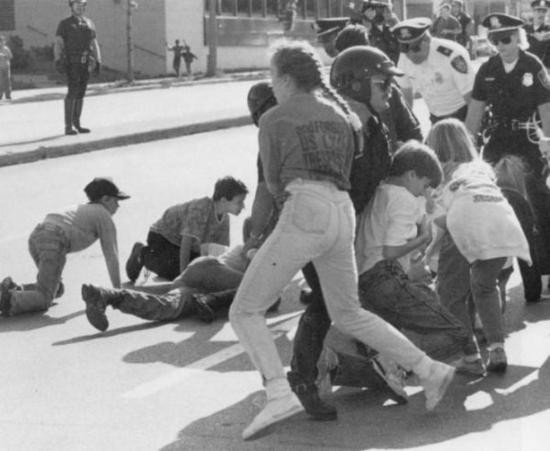 Pro-life demonstrators (and their children) attempt to rush a clinic in Milwaukee in the 1980s. - FILE PHOTO FROM MILWAUKEE POLICE