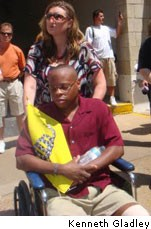 "Gladney in a wheelchair two days after his ""beating"". - THINKPROGRESS.ORG"