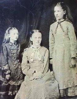 Laura Ingalls (right) and her sisters Carrie and Mary sometime in the 1870s. - IMAGE VIA
