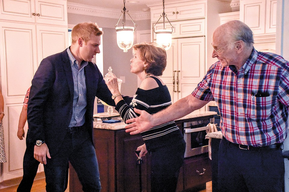 VanOstran talks with Democratic boosters Anne and John Bedwinek during an event at their home in Kirkwood. - DOYLE MURPHY