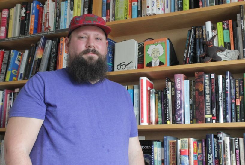 Jared Rouke, founder of Queer Young Cowboys, aims to find books that hit readers in the head, heart and crotch. - DANNY WICENTOWSKI