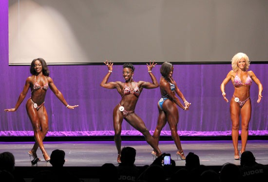 Competitors in the Figure class strike their best poses. Kahlia Brookins (far left) won first place. - DANNY WICENTOWSKI