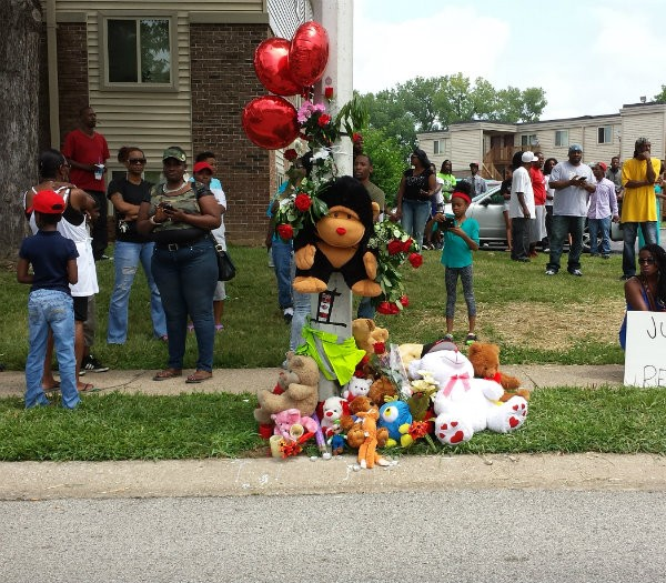 The day after Michael Brown died, supporters had already built the memorial near the spot where he was killed. Tuesday, the memorial went up in flames. - JESSICA LUSSENHOP