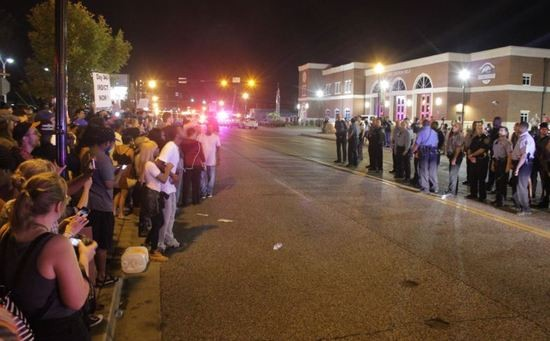 Eight people were arrested Sunday while protesting outside the Ferguson Police Department. - DANNY WICENTOWSKI
