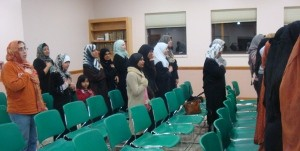 Muslim women take part in the Pledge of Allegiance during last night's event
