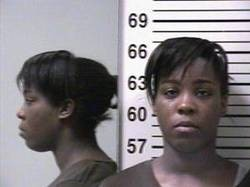 Jacqueline Baron is in custody; her accomplice remains on the loose. - PHOTOS VIA KMOV.COM