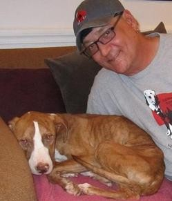 Stray Rescue's Randy Grim and Our Little Girl, a mutt rescued in north city last fall. - CHAD GARRISON