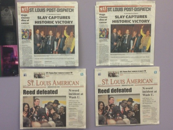Newspapers on one wall of Slay's campaign office. - SAM LEVIN