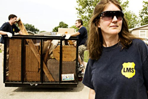 Laura Smith of Landlords Moving Service stands guard during an eviction - PHOTO BY JENNIFER SILVERBERG