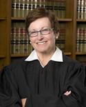 U.S. District Judge Nanette K. Laughrey - VIA