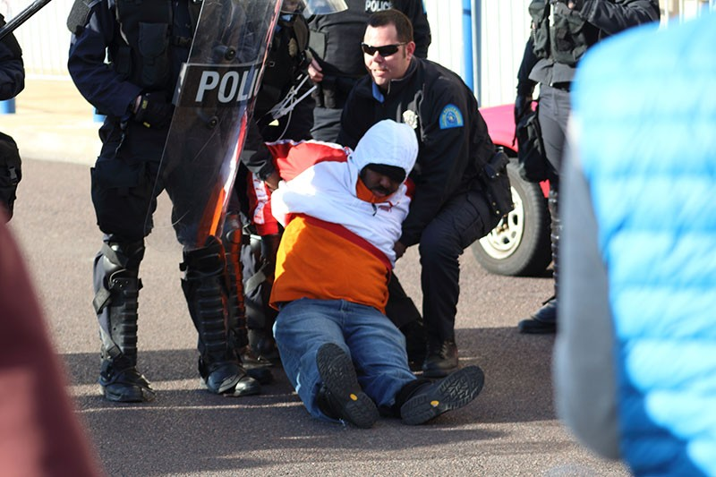 A protester gets arrested outside St. Louis Metropolitan Police headquarters on New Year's Eve morning. - PHOTOS BY SADIYYAH RICE