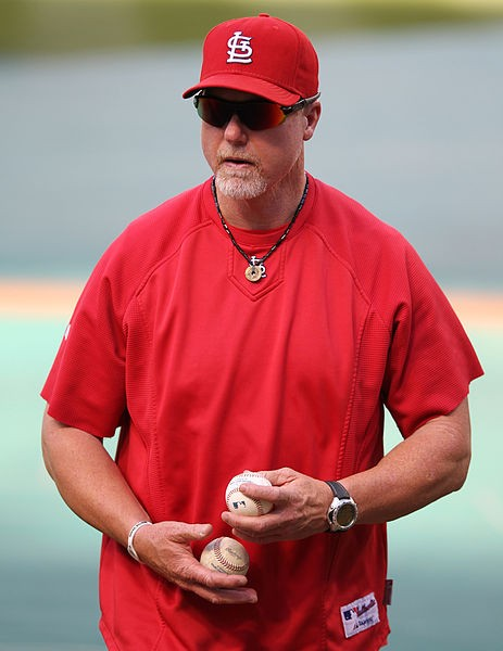 Mark McGwire is one of five coaches from Tony La Russa's 2011 staff who will return next season under new manager Mike Matheny. - COMMONS.WIKIMEDIA.ORG