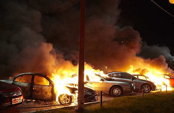 Cars at a dealership were set on fire.