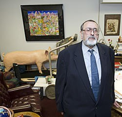Anzalone posing last year in his cluttered Clayton law office. - PHOTO: JENNIFER SILVERBERG