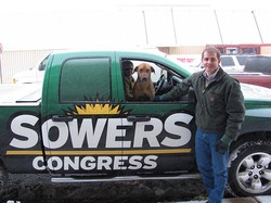 Sowers on the road with his dog, Chuck.